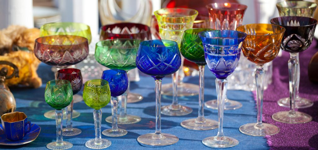 close-up of colorful crystal glasses at the Mauerpark market in Berlin, Germany